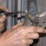 repair garage door rollers